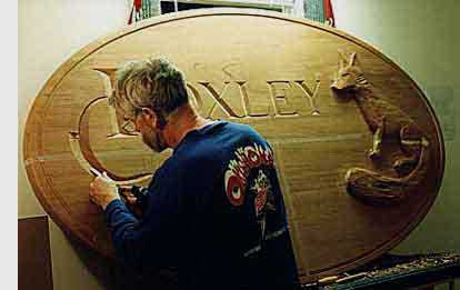 Malcolm carving a sign